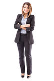 Cute salesperson with arms crossed. Beautiful young Hispanic salesperson wearing a suit and standing against a white background stock images