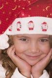 Cute Santa. Little girl wearing Santa hat Royalty Free Stock Photography