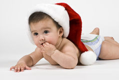 Cute Santa Baby. A beautiful little baby girl wearing a big Santa hat Royalty Free Stock Photography