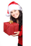 Cute Santa with Christmas gift. Cute Santa with Christmas present hiding behind white board Royalty Free Stock Image