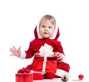 Cute Santa Claus baby girl with gift box Stock Photo