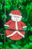 Cute Santa claus doll ornament on Christmas Tree Stock Images