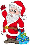 Cute Santa Claus with gifts Stock Photos