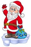 Cute Santa Claus with gifts on snow Royalty Free Stock Images