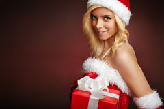 Cute santa claus girl with gift box. Beautiful and sexy santa claus girl with gift box Royalty Free Stock Photo