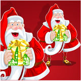 Cute Santa Claus give a gift on red background Stock Photography