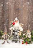 Cute Santa Claus and happy kids in snow Stock Image