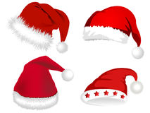 Cute Santa Claus hats. Vector pretty red Santa Claus hats for Christmas Royalty Free Stock Photography