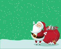 Cute Santa Claus standing in the snow with a bag of gifts Stock Image