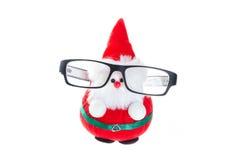 Cute santa doll with eye glasses. Stock Photos