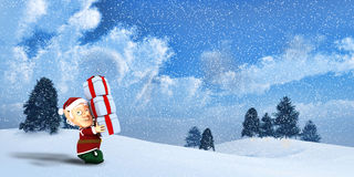 Cute Santa elf on a winter Landscape Stock Photo