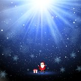Cute Santa and gift on snowflake background. Cute Santa Claus and a gift on a snowflake background with a starburst design Stock Image