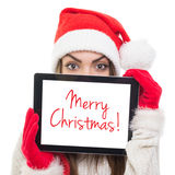 Cute Santa girl hiding behind tablet computer Stock Photography