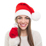 Cute Santa girl showing silver star Christmas decoration Royalty Free Stock Image