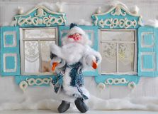 Father Frost and retro Russian house. Cute Santa and old wooden house - vertical Christmas photo Stock Photography