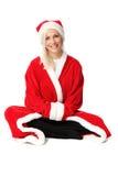 Cute santa sitting down Stock Images