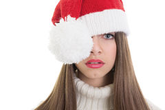 Cute Santa teenage girl posing with one eye covered Stock Image