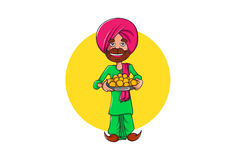 Cute Sardar ji holding a plate of sweets and smiling. Royalty Free Stock Image