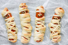 Cute sausage mummy fun food for kids. Close up royalty free stock image