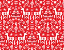 Christmas folk art vector seamless pattern with reindeer, flowers, Xmas tree and winter clothes design in white on red backgrou. Cute Scandinavian style retro vector illustration
