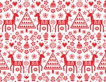 Christmas folk art vector seamless pattern with reindeer, flowers, Xmas tree and winter clothes design in red on white background stock illustration