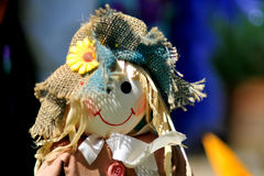 Cute scarecrow doll. Picture is taken at: 'Scarecrows go Racing' charity collection parade in Winkfield, United Kingdom Royalty Free Stock Image