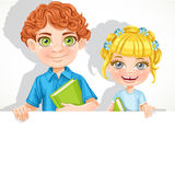 Cute school boy and girl with book hold big banner Royalty Free Stock Images