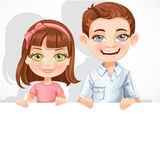 Cute school boy and girl hold a banner Royalty Free Stock Photo