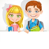 Cute school boy and girl with textbooks hold a banner Royalty Free Stock Photo