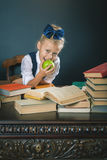 Cute school girl eating delicious green apple Royalty Free Stock Photography