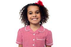 Cute school girl posing in uniform Royalty Free Stock Photo