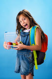 Cute school girl shows her healthy lunch box Stock Photo