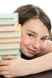 Cute school girl with stack of books Royalty Free Stock Image