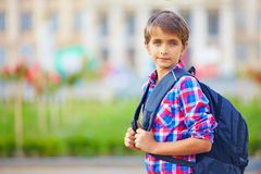 Cute schoolboy with backpack, outdoors Royalty Free Stock Image