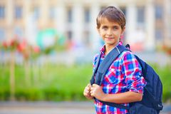 Cute schoolboy with backpack, outdoors Stock Photo