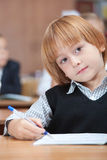 Cute Schoolboy in dreams stock photo