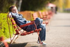 Cute schoolboy in a park Royalty Free Stock Photo