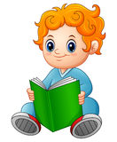 Cute schoolboy reading a book Royalty Free Stock Images