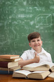 Cute schoolboy showing thumbs up Royalty Free Stock Image