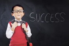 Cute schoolboy with Success word in class Royalty Free Stock Photos