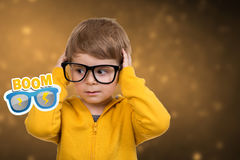 Cute schoolboy thinking idea while wearing glasses and looking at up,  Royalty Free Stock Images