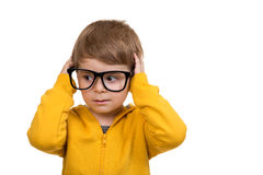 Cute schoolboy thinking idea while wearing glasses and looking at up, isolated Royalty Free Stock Photos
