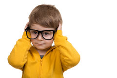 Cute schoolboy thinking idea while wearing glasses and looking at up, isolated Stock Photo