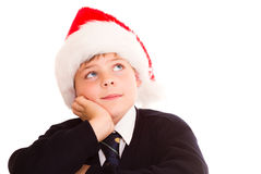 Cute schoolboy waiting for the holidays. Wearing in a school uniform. Isolated on white Royalty Free Stock Photo
