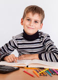 Cute schoolboy is writing Stock Photos