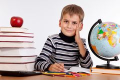 Cute schoolboy is writting Royalty Free Stock Photography