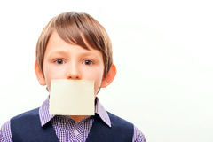Cute schoolchild in suit with a sheet of paper on Royalty Free Stock Image