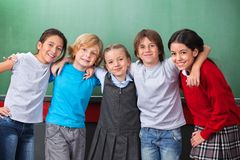 Cute Schoolchildren With Arms Around Standing Royalty Free Stock Image