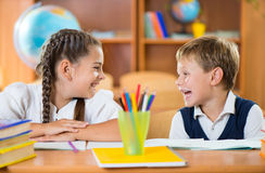 Cute schoolchildren having fun in classroom Royalty Free Stock Photos