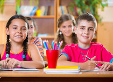 Cute schoolchildren during lesson in classroom Stock Photos